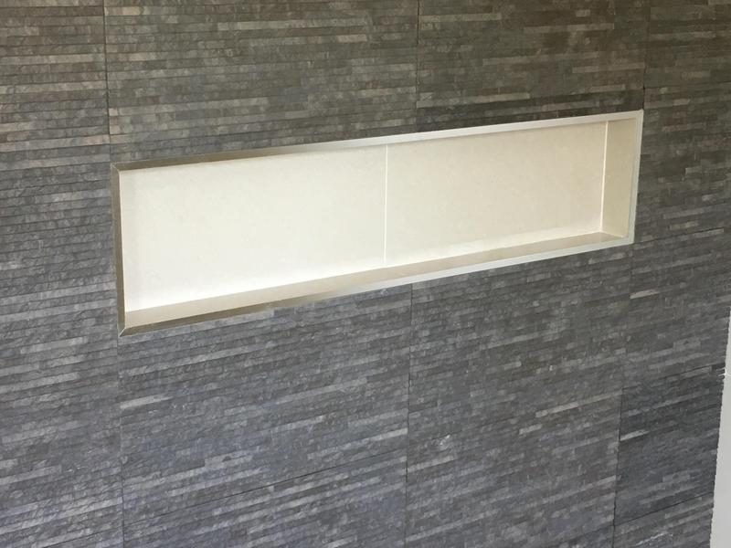 Image 21 - bathroom - walls and floor in 600 x 600 porcelain tiles with a feature wall with recess