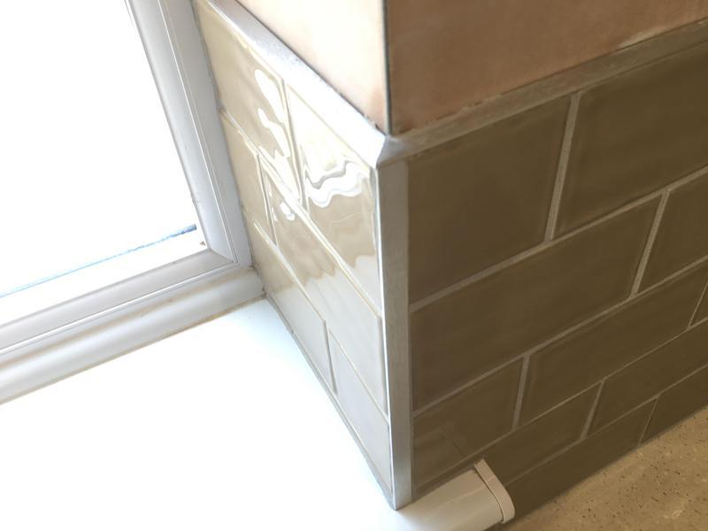 Image 29 - kitchen floor and splash back, Floor levelled and tiled in a modular floor tile. Splash back in metro tiles