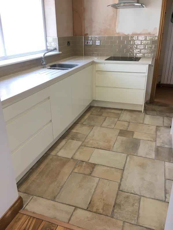 Image 28 - kitchen floor and splash back, Floor levelled and tiled in a modular floor tile. Splash back in metro tiles