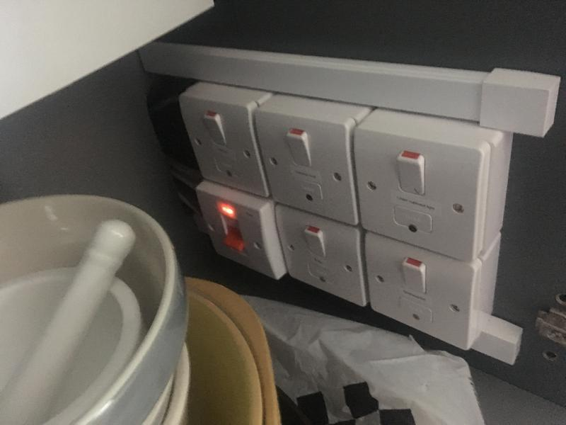 Image 8 - Kitchen appliance spurs and oven switch in a cupboard rather than out on show