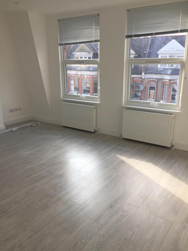 Image 21 - Stripped out room, insulated, plastered and painted. Fitted new windows and laminate flooring