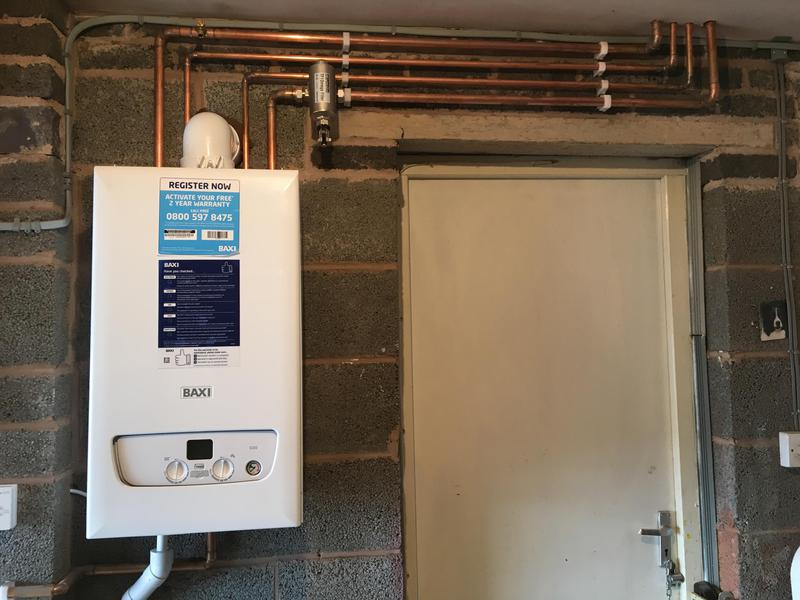 Image 9 - New Baxi boiler fitted in garage complete with magnetic filter and pipes lagged