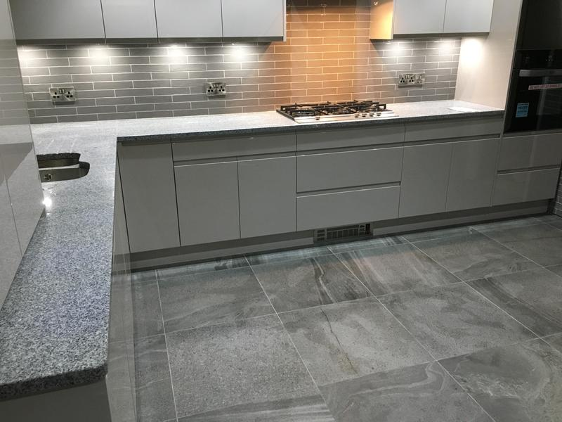 Image 76 - kitchen makeover - floor levelled - tiled in 600 x 600 tiles - walls tiled in metro tiles