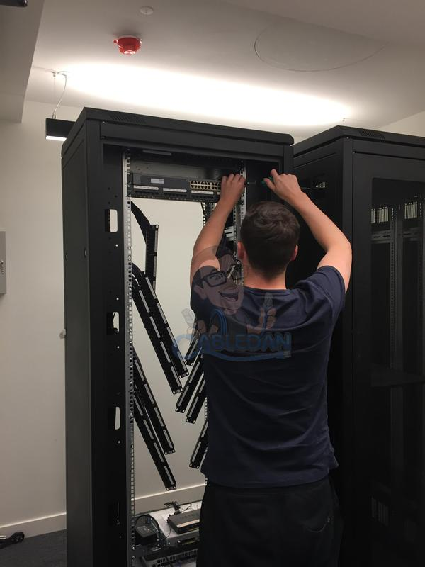 Image 11 - Patch panels being installed