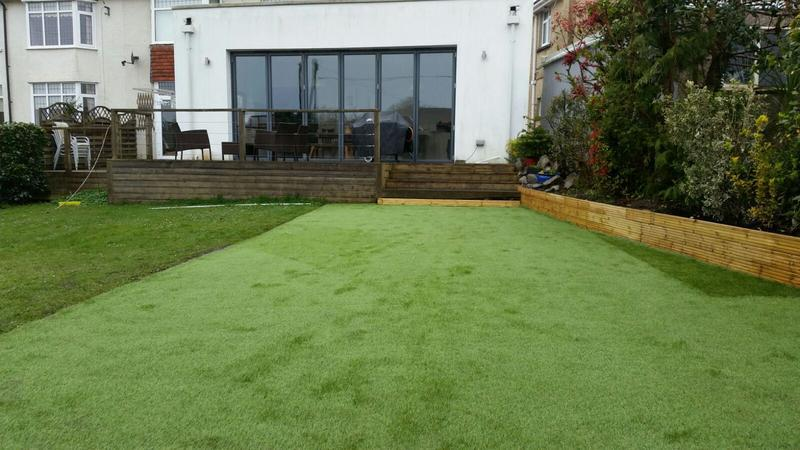 Image 24 - Fake grass laid outside new home gym