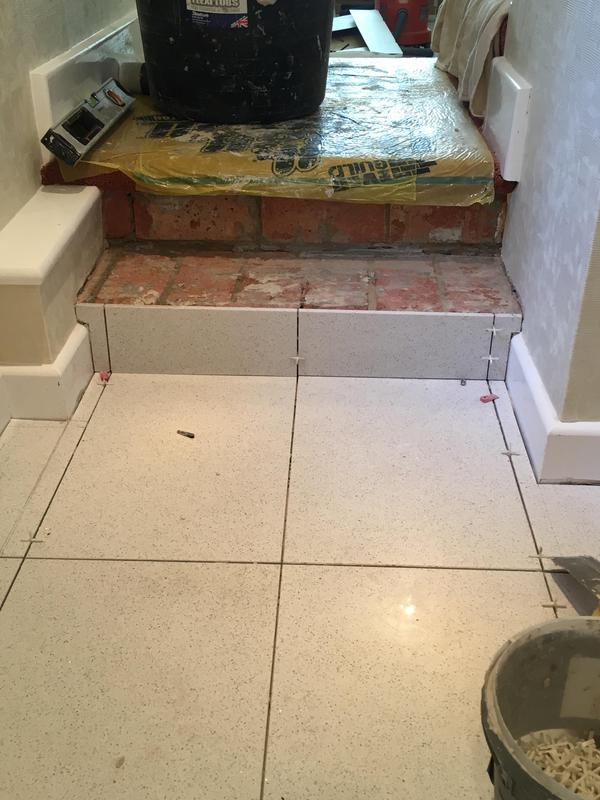 Image 80 - downstairs loo - floor levelled - then tiled in quartz tiles