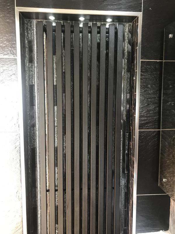 Image 46 - Enclosed tall radiator with spot lights to make it a feature on a wall