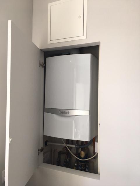 Image 3 - New boiler Installed with access panel to conform with gas regulations