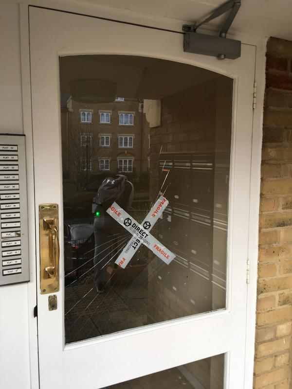 Image 5 - broken glass in communal door, clapham