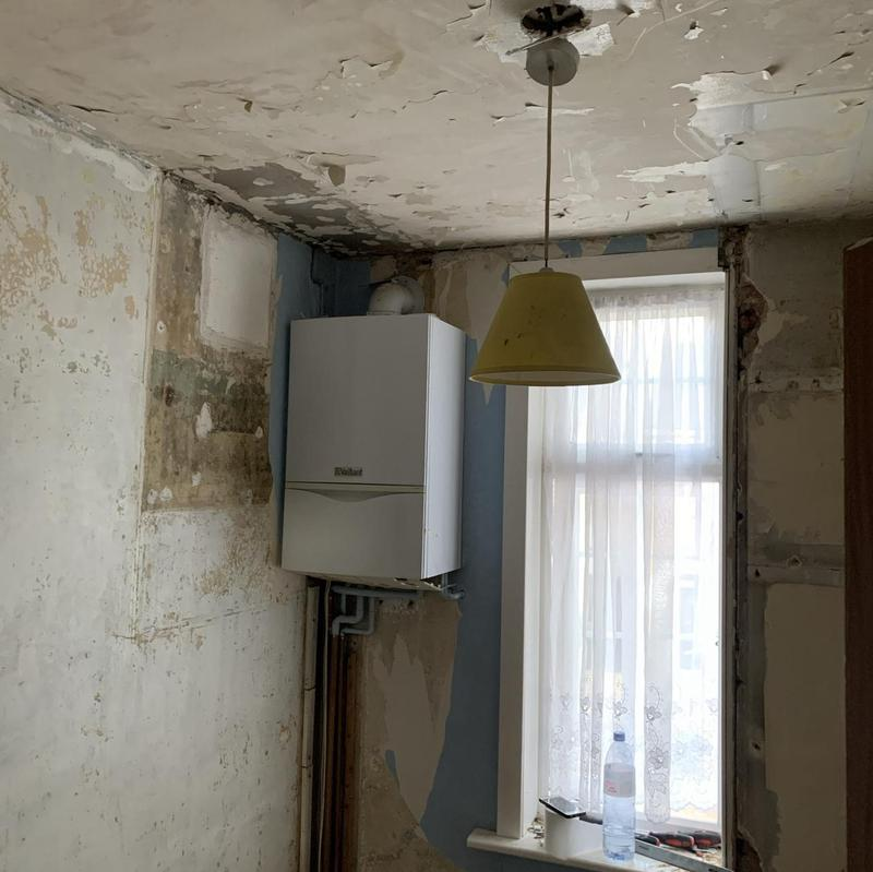 Image 17 - before the boiler was removed with damaged ceiling and walls.