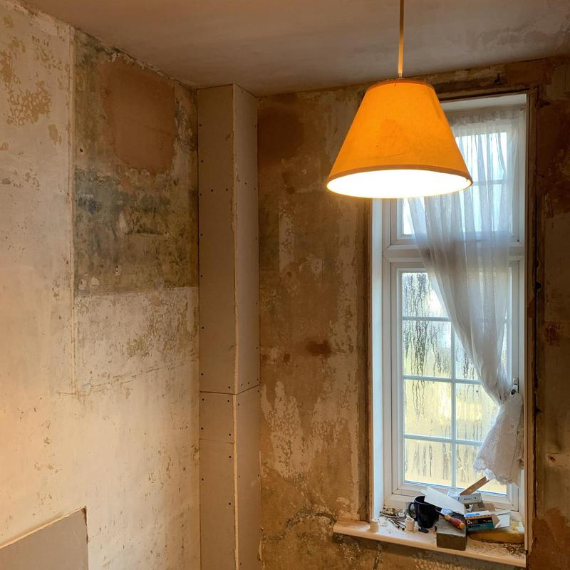 Image 18 - boxed in pipes and ceiling plastered