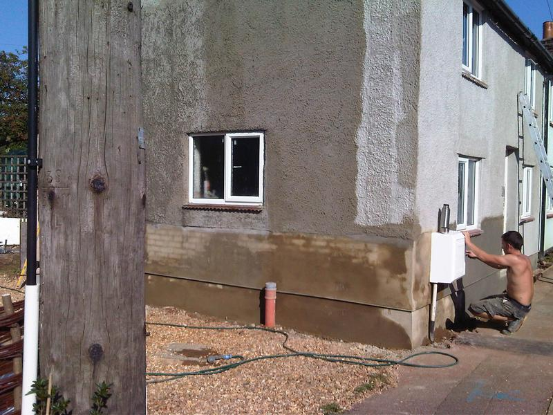 "Image 8 - re render bottom of house with ""bagging"" applied to pebbledash to blend in with the rest of the street. This was to stop penetrating damp and repair the damaged render due to the damp issue inside. This has also been rectified inside"