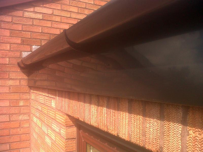 Image 8 - the plain black fascia with black guttering