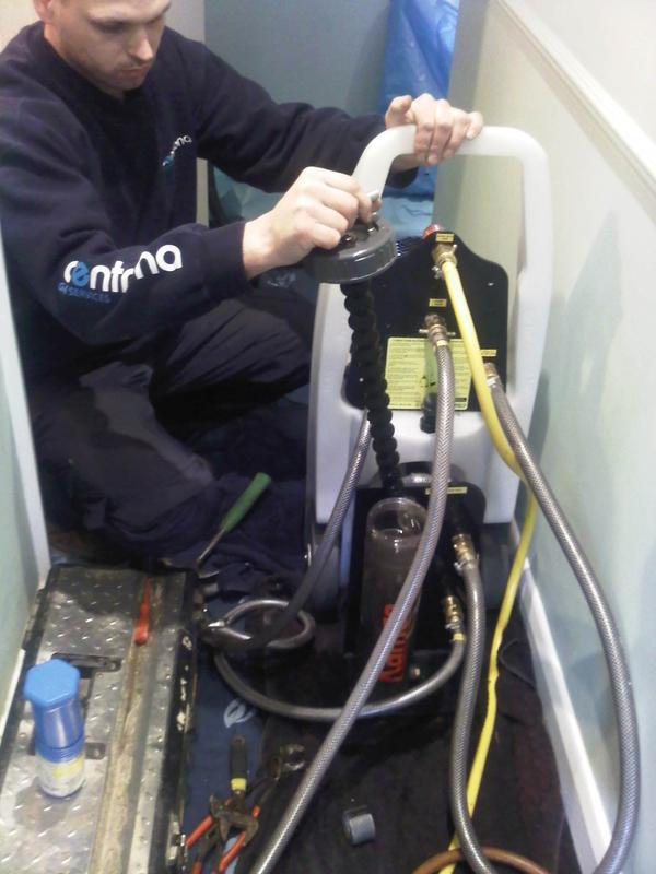 Image 8 - an installer carrying out a powerflush