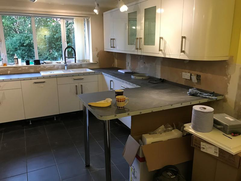 Image 22 - Curved wall units with a breakfast bar coming off