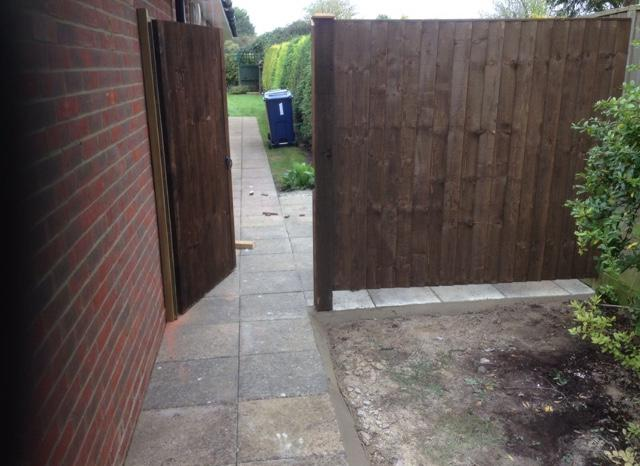 Image 25 - Side access gate & fence with paving as well .