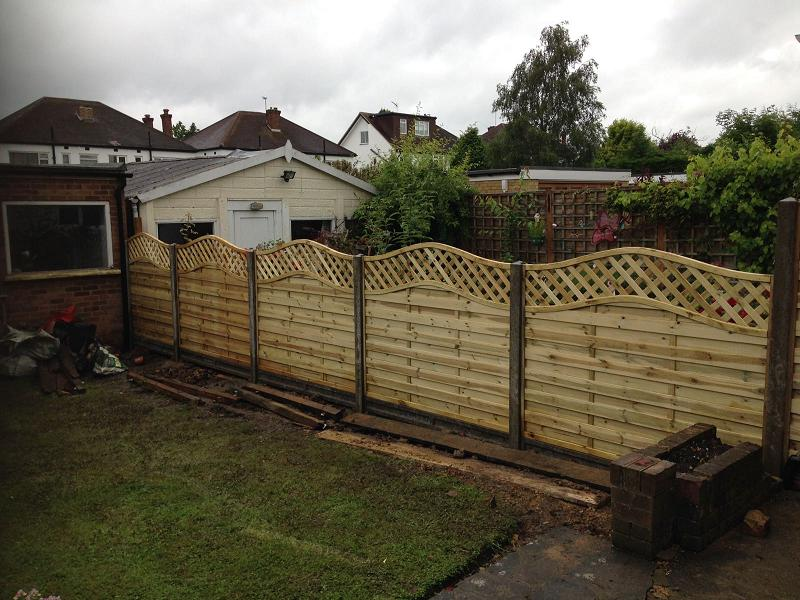 Image 30 - Omega panels with built in trellis & waves paternity tops, using concrete slotted posts & concrete gravel boards .