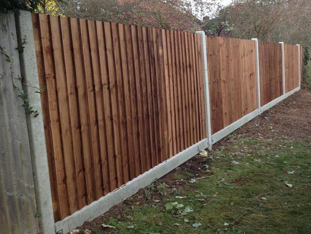 Image 34 - Standard close board featheredge fencing using concrete posts & gravel boards .
