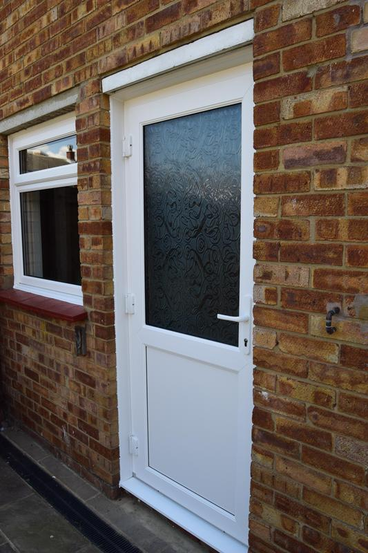 Image 37 - UPVC rear door with Toughened safety glass and Re-inforced panel as standard