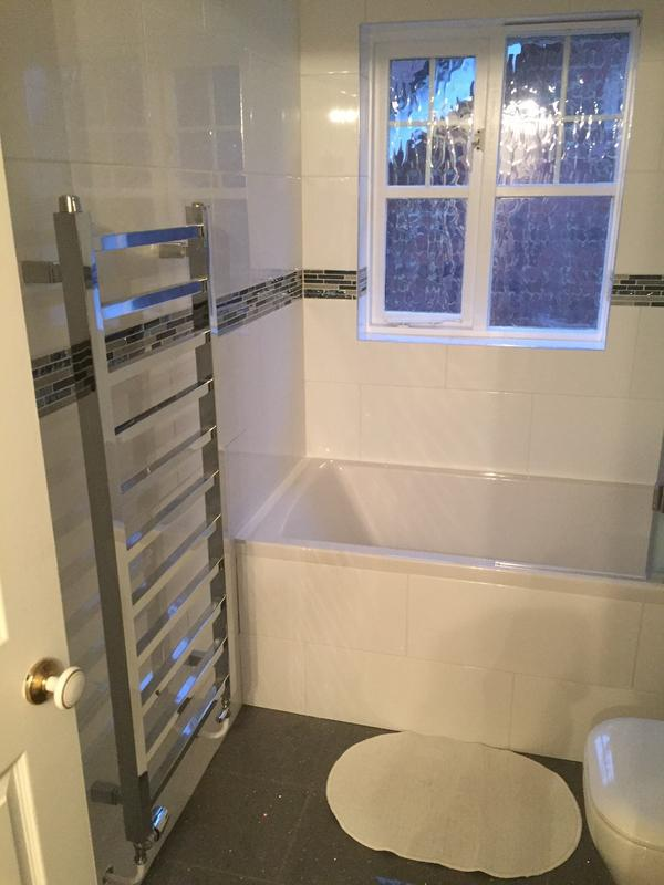 Image 17 - Fully tiled walls and bath panel with porcelain floor tiles