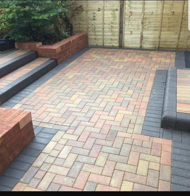 Image 14 - New patio installation with brick retaining walls and steps