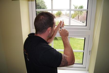 Image 1 - Keytek Local Locksmith working on a uPVC window
