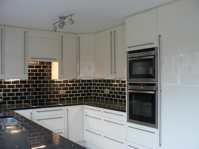 Image 12 - Oyster Gloss units, New Ceiling Quartz worktops, Neff Appliances,