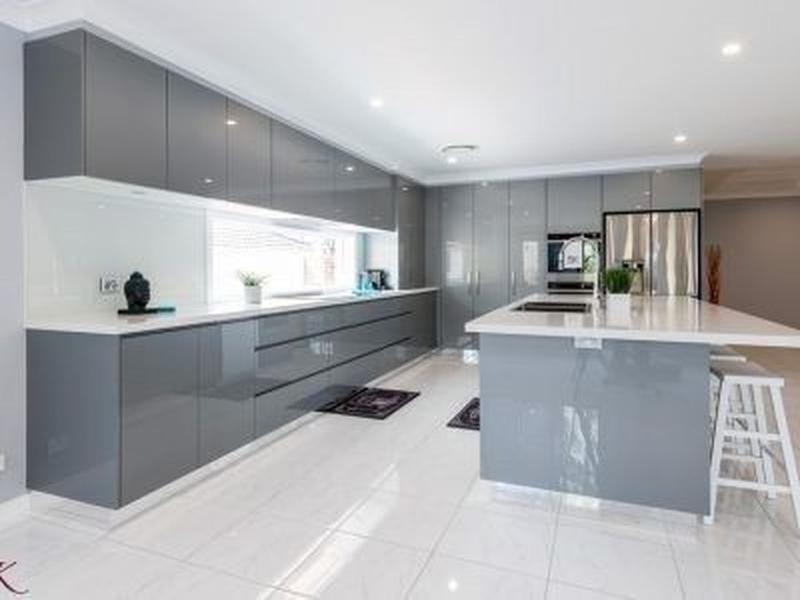 Image 5 - Gloss grey handless kitchen. White Quartz worktops with white porcelain floor tiles. Electric underfloor heating