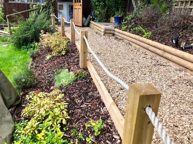 Image 3 - Landscaped pathway with raised beds