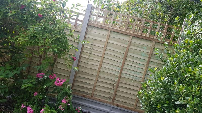Image 170 - Lap panel fencing on concrete gravel boards and concrete posts