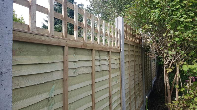 Image 171 - Lap panel fencing on concrete gravel boards and concrete posts