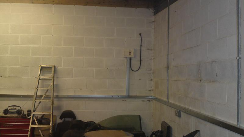 Image 1 - 2x2 galv trunking wrapped around the garages waist with socket outlets accordingly.