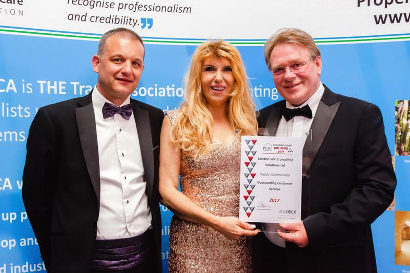 Image 3 - Steve Hodgson, Chairman of the PCA presenting the commendation award for outstanding customer service to Peter Barber (Managing Director) and Alexander Schinas of London Waterproofing Solutions LTD