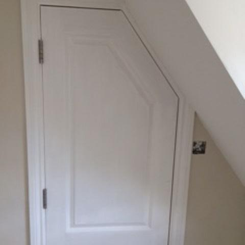 Image 53 - An eye for detail, door cut to shape, repaired, routered and new mouldings to match.