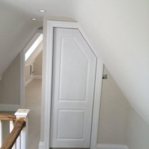 Image 51 - A view of the two doors cut and adjusted to suit the ceiling line.