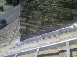 Image 17 - Lead step flashings to chimney stack