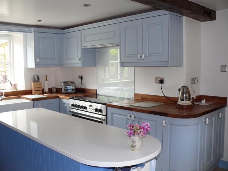 Image 12 - Painted timber. Walnut worktop. Quartz island.