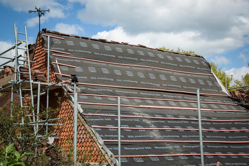 Image 14 - All old tiles, felt and battens removed and being replaced on M house.