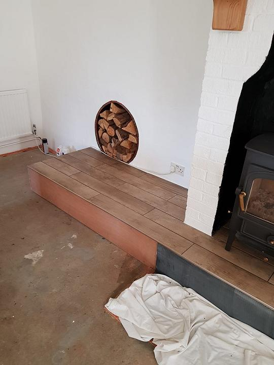 Image 44 - Tiled fireplace ready for carpet to be laid