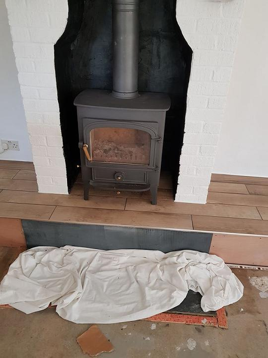 Image 49 - Tiled fireplace ready for carpet to be laid