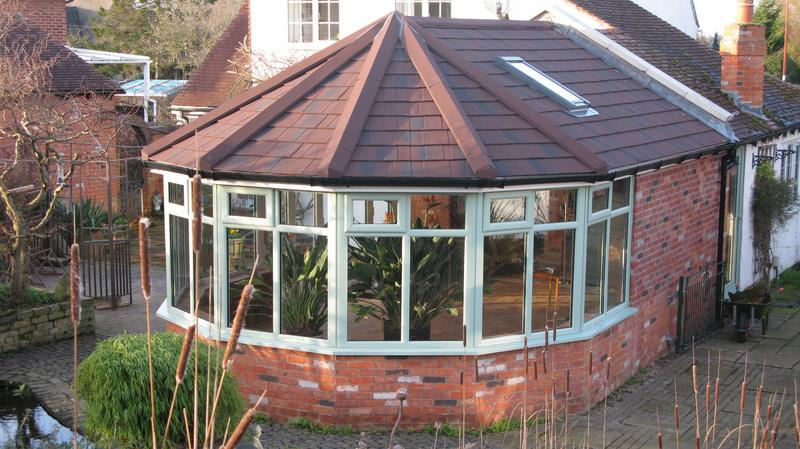 Image 7 - victorian supalite roof with chartwell green frames and doors