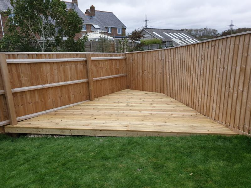 Image 176 - Bespoke built decking to fit unusual shaped garden
