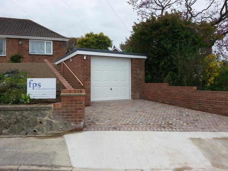 Image 1 - Project completed and the new garage is complemented by a new block paved entrance.