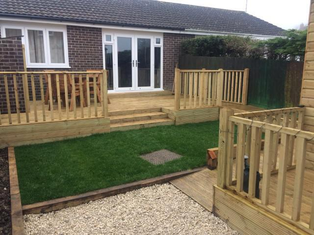 Image 188 - Decking with recessed steps, hand rail and new turfed area