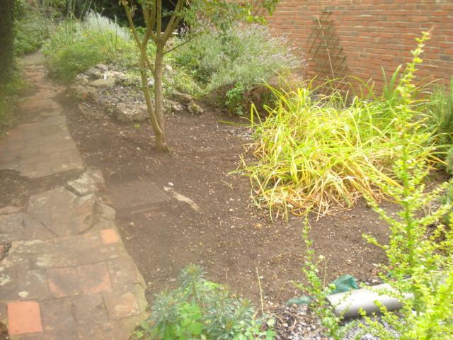 Image 32 - flower bed turned and ready for membraine and new wood bark chip