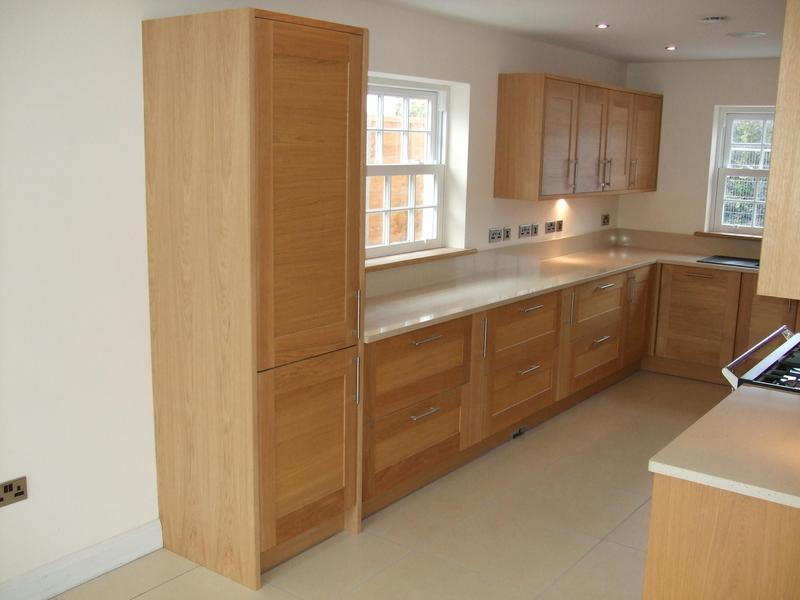 Image 35 - Oak kitchen installed in new self build project with quartz worktops.