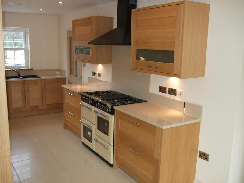 Image 36 - Oak kitchen installed in new self build project with quartz worktops.