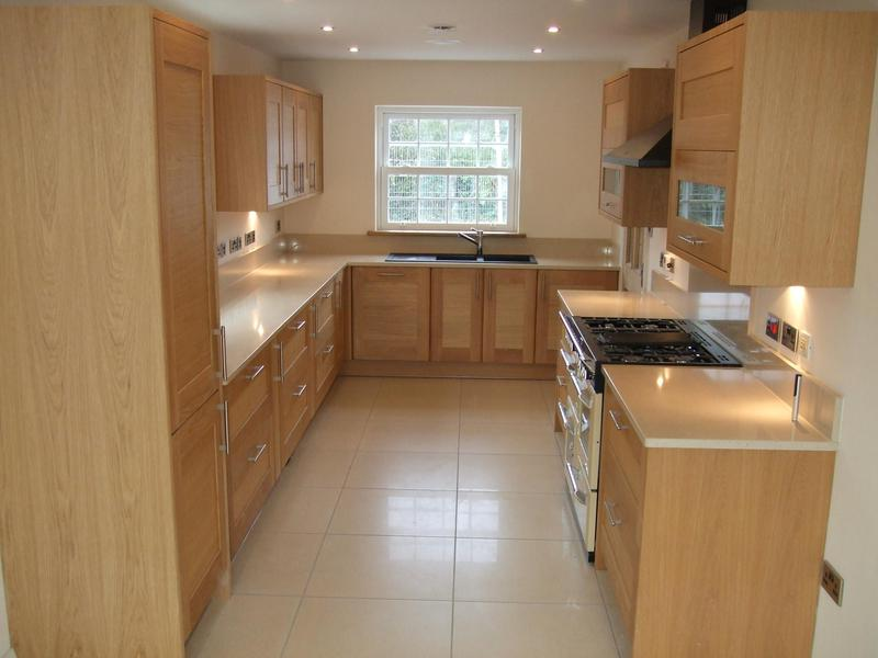 Image 37 - Oak kitchen installed in new self build project with quartz worktops.