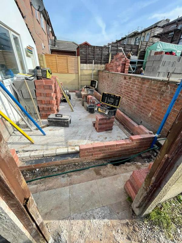 Image 107 - Oldham extension - During - concrete dried, placing bricks