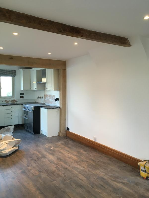 Image 14 - Open plan kitchen diner with structural oak beams by DKM Developments Ltd builders Great Dunmow Essex